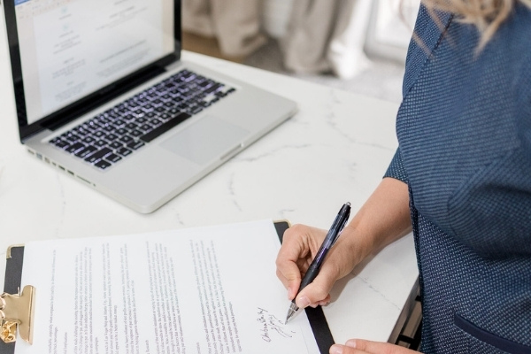 An image of a female attorney filling out a trademark registration application